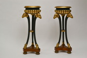 Pair of empire gilt and patinated and mahogany veneered wood gueridons, early 19th century.