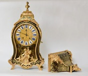 A Louis XV Ormolu-Mounted, Boulle Marquetry  Bracket Clock, on wall bracket. Signed Jean Bacquet Paris.