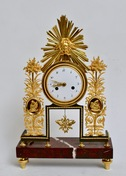 A Louis XVI Gilt Bronze and Marble Mantle Clock