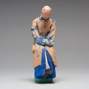 Chinese Sculptured And Painted Clay Figure Of An Elderly woman.19th century
