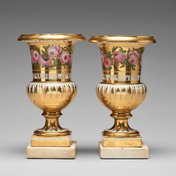 Pair of French porcelain urns on marble bases