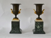Pair of empire gilt bronze and patinated bronze urns on marble bases