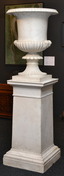 An important 19th century Italian Carrara marble urn on original marble stand