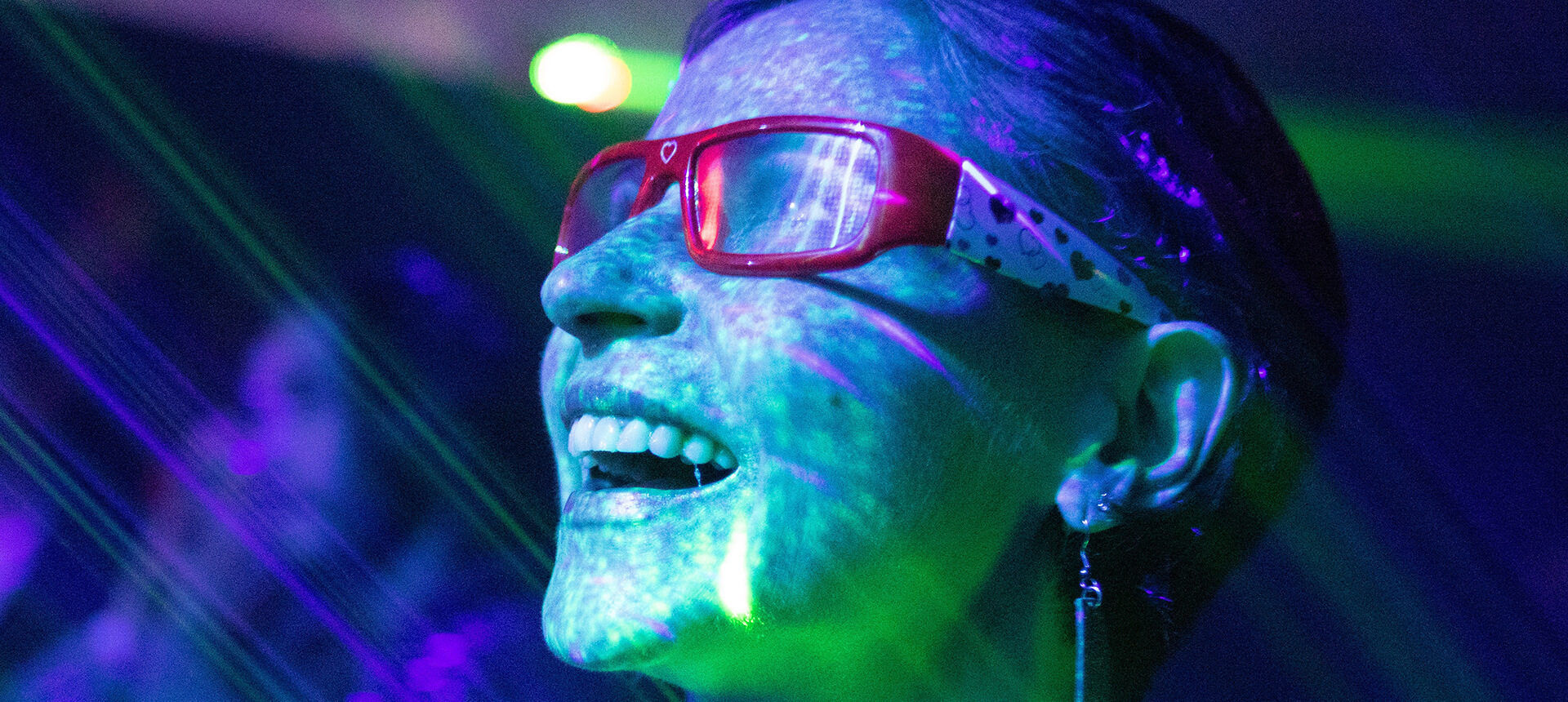Girl with glasses in neon lights