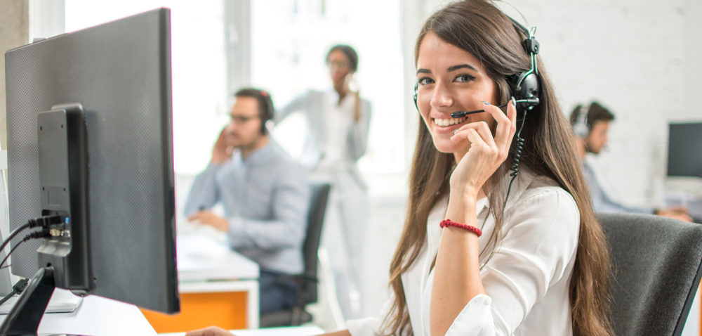 Woman with headset working with multilingual customer service