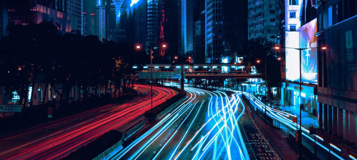 Big city lit up by neon lights